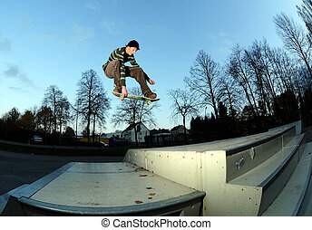 skateboarder in action at the local skate park.