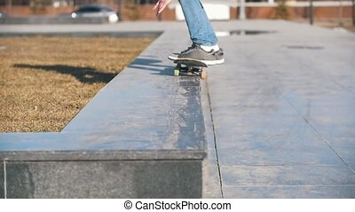 Skateboarder jumping to the ramp on the board, close up,...