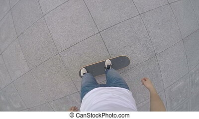 skateboarder legs riding skateboard