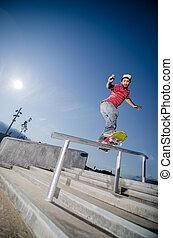 Skateboarder on a flip trick at the local skatepark.