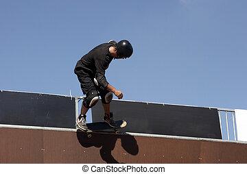 Skateboarder on a wave ramp