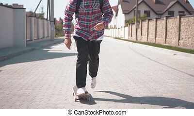 Skateboarder on the Street - Hipster skateboarder starts to...