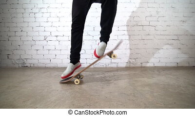 Skateboarder performing skateboard trick - ollie on concrete. Athlete practicing jump, preparing for competition. Extreme sport, youth culture, urban style