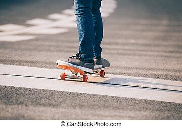 Skateboarder sakteboarding on city street
