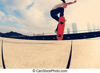 skateboarder skateboarding in city