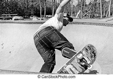 Skateboarder Skating a Bowl - Action shot of a skateboarder...