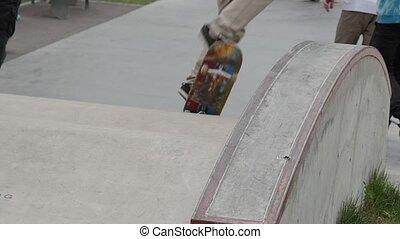 Skateboarder sliding on a ledge in skate park