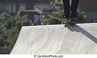 Skateboarders dropping a ramp