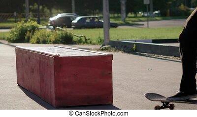 Skateboarder's stunt. Jump on the skater box, slide and ride...