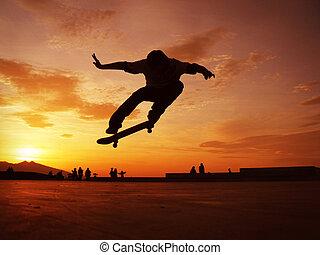 Skateboarding - Silhouettes of skateboarder mid air