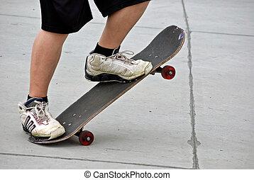 Skateboarding - Teenage boy posing with his skateboard.