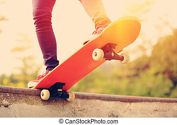 skateboarding woman legs - skateboarding woman legs at...