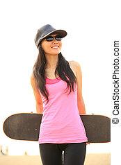 skateboarding woman on beach