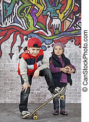 Skater boy with a little girl