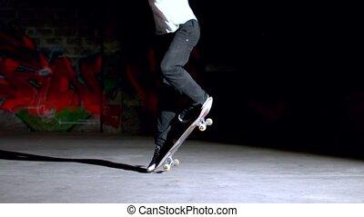 Skater doing backside 360 trick in slow motion