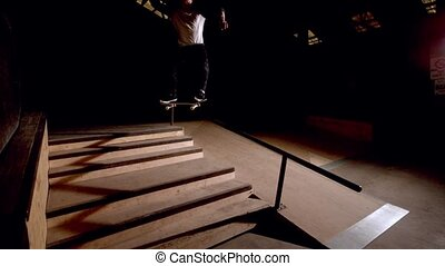 Skater doing crook down handrail in slow motion