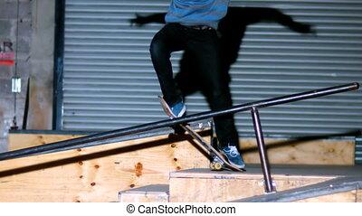 Skater doing crook slide down rail - doing crook slide down...