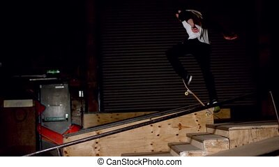 Skater doing dipped ollie down steps in slow motion