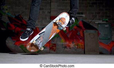 Skater doing double flip trick - Close up of skater doing...