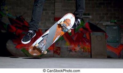 Skater doing double flip trick - Close up of skater doing...