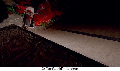 Skater doing frontside 5-0 along top of ramp in slow motion