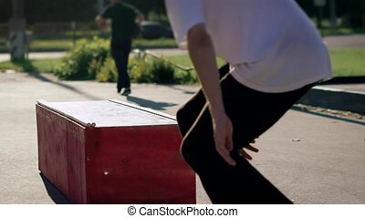 Skater doing stunt with his skateboard. He jumps over the...