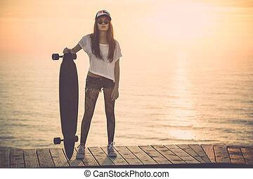 Skater Girl - Beautiful and fashion young woman posing at ...
