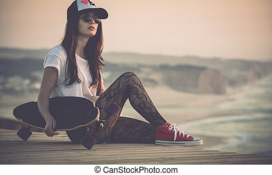 Skater Girl - Beautiful fashion skater girl posing with a...