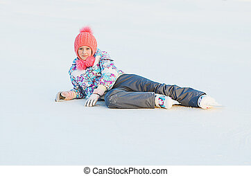 skater girl is lies on the ice