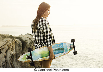 Skater Girl - Beautiful and fashion young woman posing at...