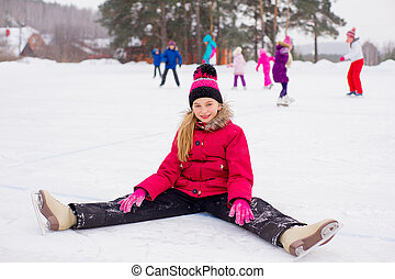 skater girl sitting on the ice