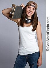 Skater Girl - Smiling skater girl holding skateboard