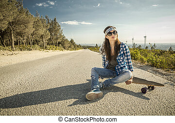 Skater Girl - Beautiful young woman sitting over a...