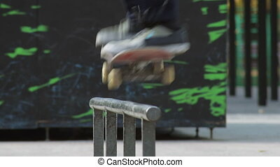 Skater jump on a rail with trick 50-50 grind, detailed view...