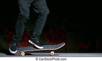 Skater performing 360 flip trick in slow motion