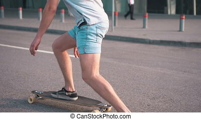 Skater Rides on Road - Skater having a ride along the road...