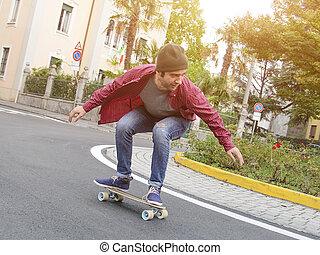 skater riding his skate in the city street