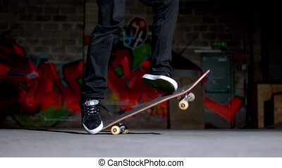 Skater rolling into kickflip trick in slow motion