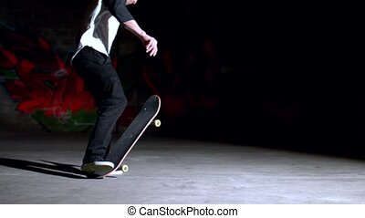 Skater rolling into no comply 180 trick in slow motion