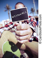skater shows a signboard with the text millennials