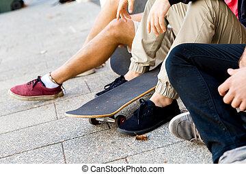 Skaters having a break at the street