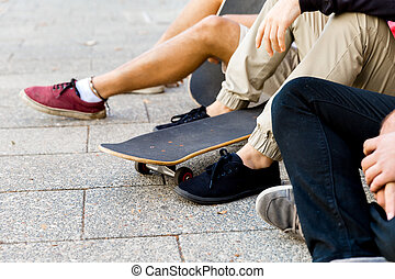 Skaters having a break at the street
