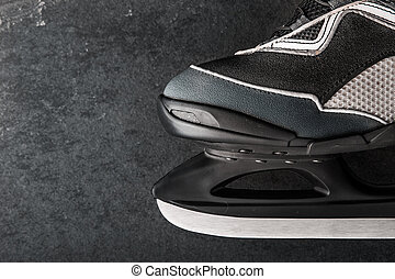 Skates on the dark stone