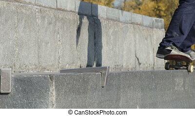 Skatestopper or anti-skate device in work on street granite ledge on monument
