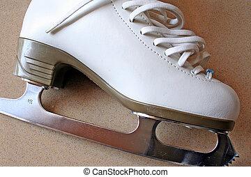 Skating Boot - A white skating boot.