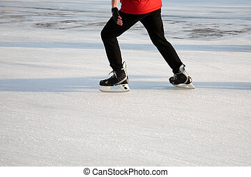 skating on the ice in sunny weather