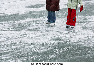 skating rink - mother with child on skating rink