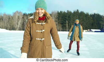 Skating Romance - Slow motion of attractive lady skating...