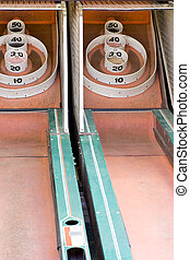 2 lanes of a skeeball game from a traveling amusement company.