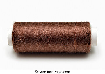 skein of brown thread is isolated on a white background
